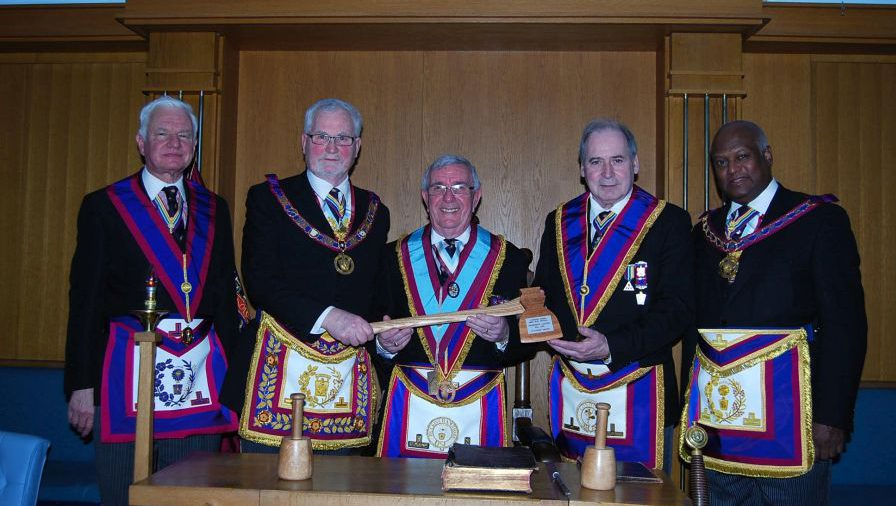 Lucky 13 as Henniker 315 are presented with the 13th Axe by RW Bro David Ashbolt, PGM on Friday 6th February