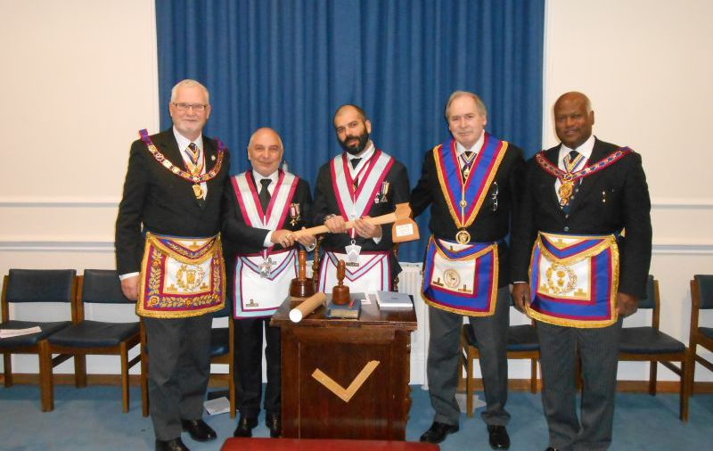 The Provincial Grand Master RW. Bro. David Ashbolt presents axe to Foundation Lodge at their meeting held on 23rd. March 2015